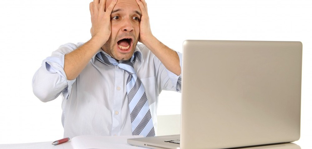 young business man in stress  frustrated with computer